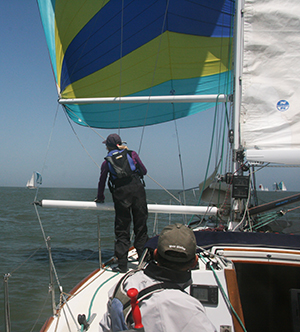 spinnaker pole and reaching strut in use on a cal 40 sailboat