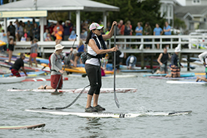person on a paddlebaord with leash attached