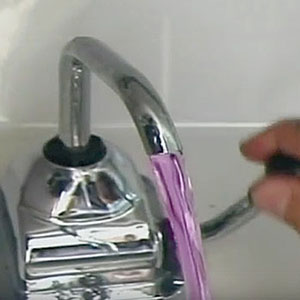 Purple antifreeze flowing out of faucet