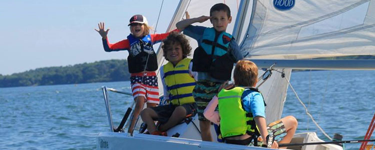 Kids on a sailboat