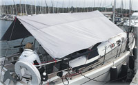 Boom-supported cockpit awning