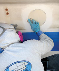 filling a hole in the boat using WEST system epoxy