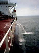 Large ship pumping ballast water