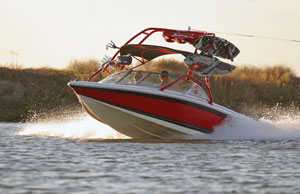 Red and white powerboat with a wakeboard tower