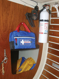 fire extinguisher, first aid kit and life jacket on a boat