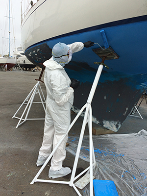 Man applying antifouling paint