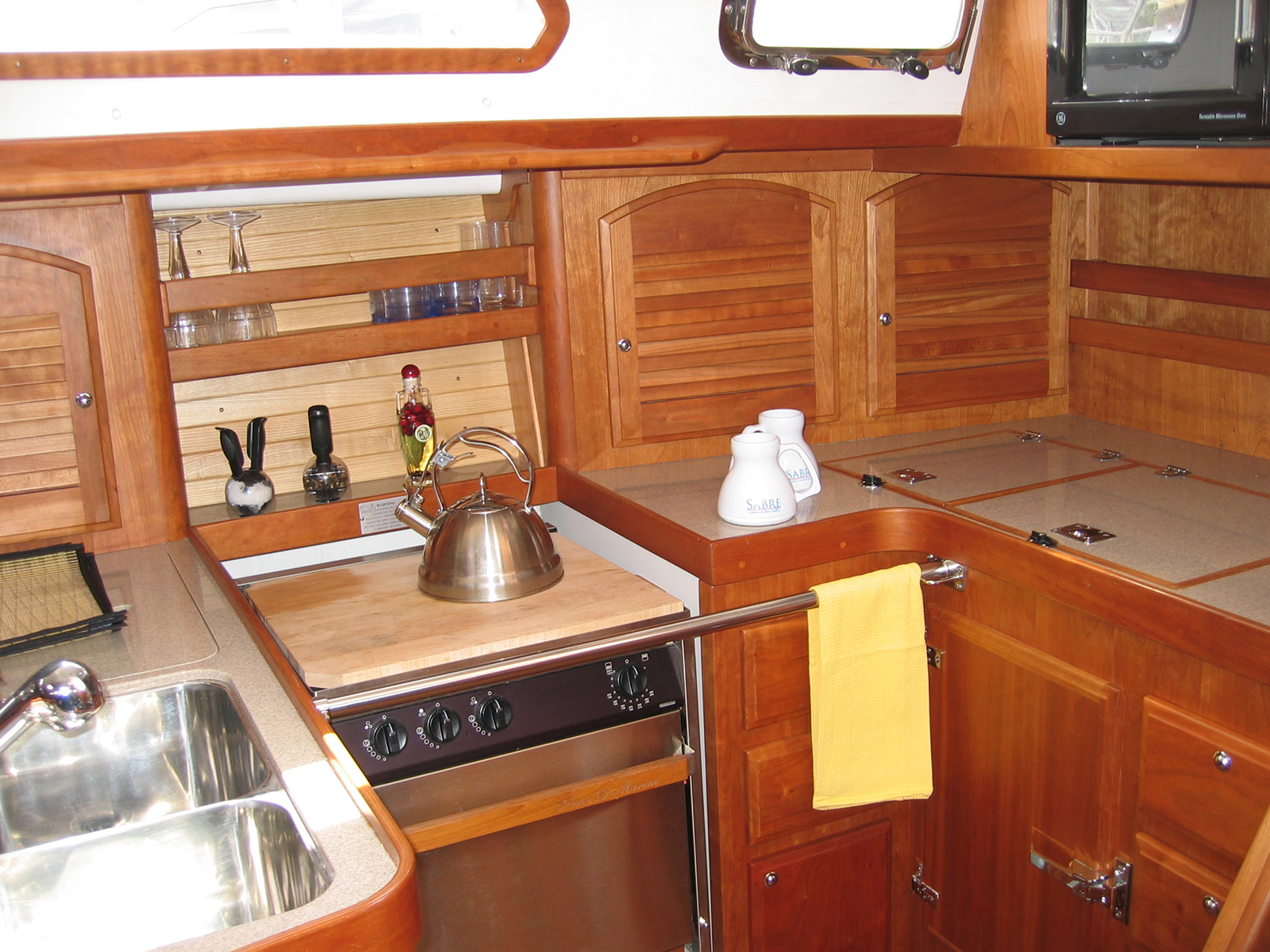 Selecting refrigeration for your boat west marine for Boat kitchen cabinets