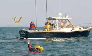 the lifesling2 being thrown to an overboard crew member