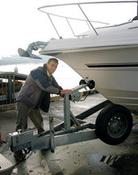 Checking the bow tiedown on a trailered boat
