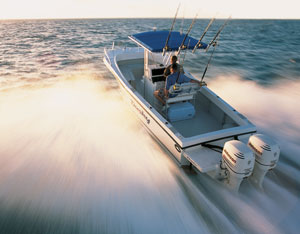 Dual outboard center console boat planing at high speed
