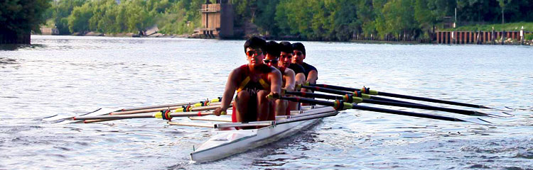 Young men on a Scull