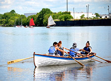 Youth rowing boat