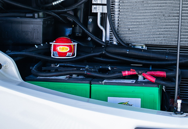 Elide Fireball installed over batteries in engine compartment