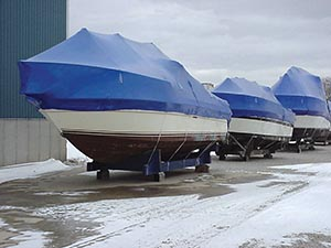 Shrink wrapped boats layed up on cradles