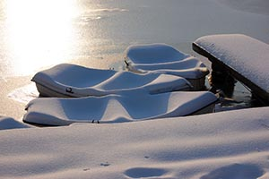 3 boats covered in snow